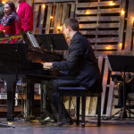 Matt Oliver plays piano with the Worship Band