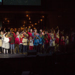 KidsChoir joins Worship Choir on stage for Hosanna (Be Lifted Higher)